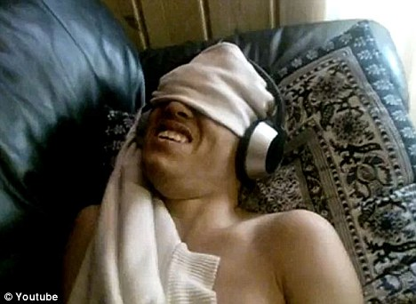 Freak out: This teenager screwed up his face and shook as he listened to a track