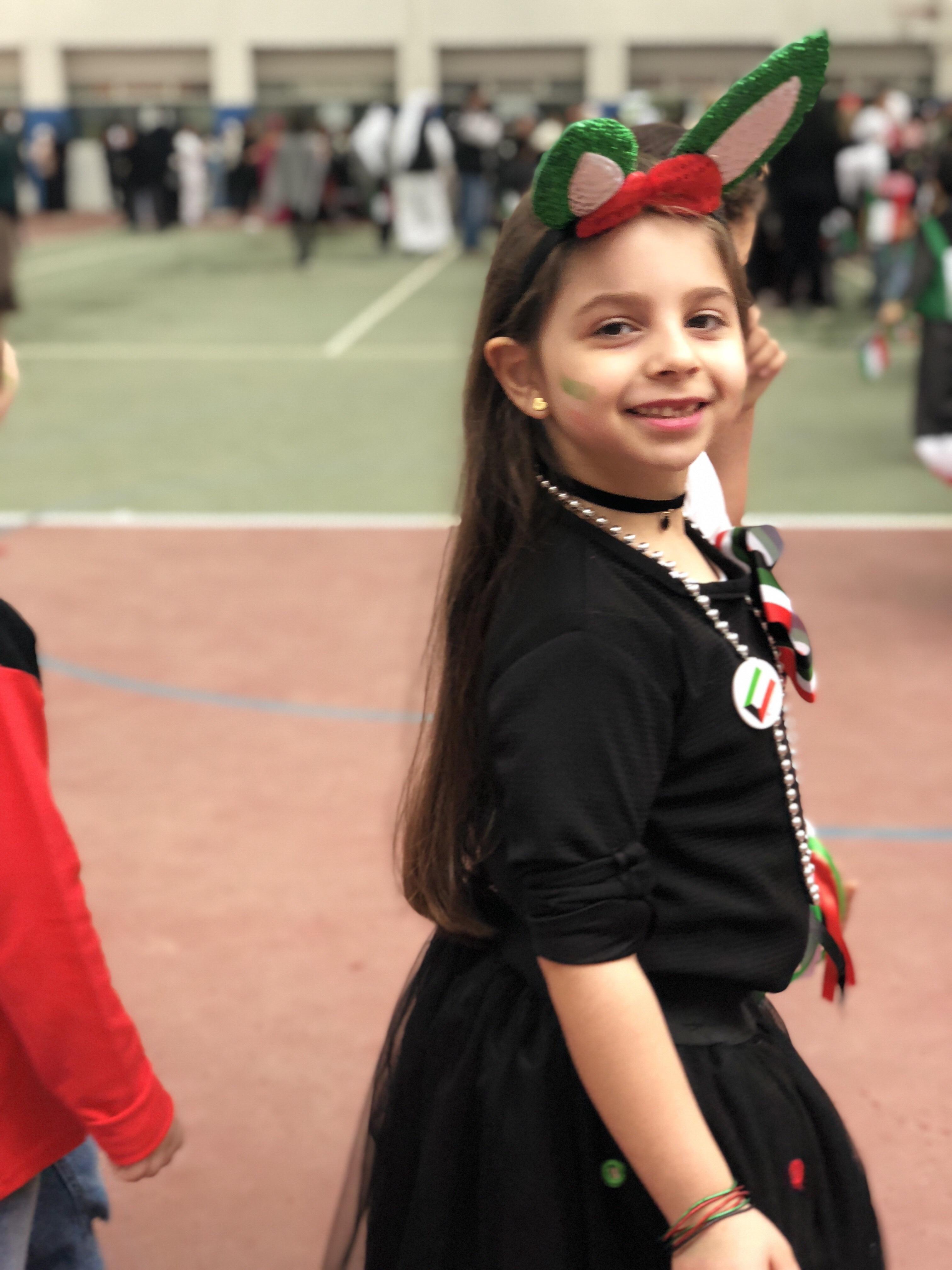 Child celebrating kuwait national day